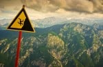 Man falling from mountain sign