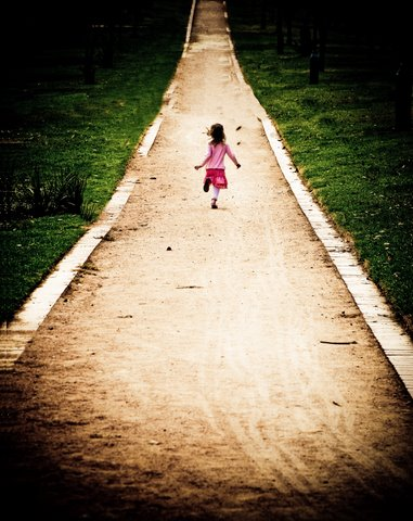 Child walking in the road
