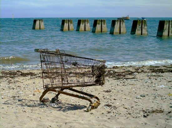 An ineffective shopping cart on the beach