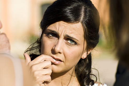 Woman with a worried look on her face