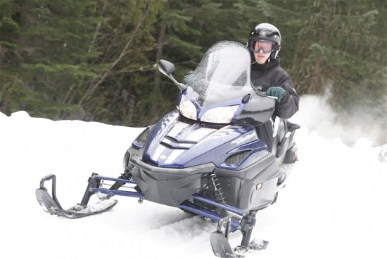 Blazing through the snow on a snowmobile