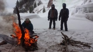 Warming up at the bonfire during an ice climb