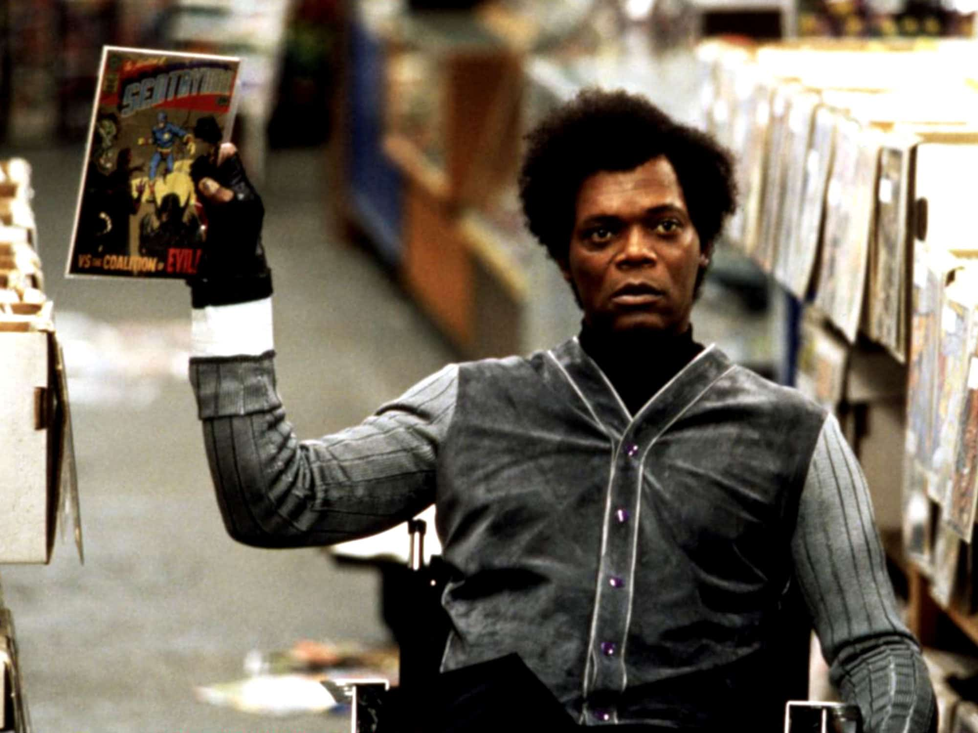 Samuel L. Jackson as Mr. Glass in Unbreakable holding Sentryman comic book