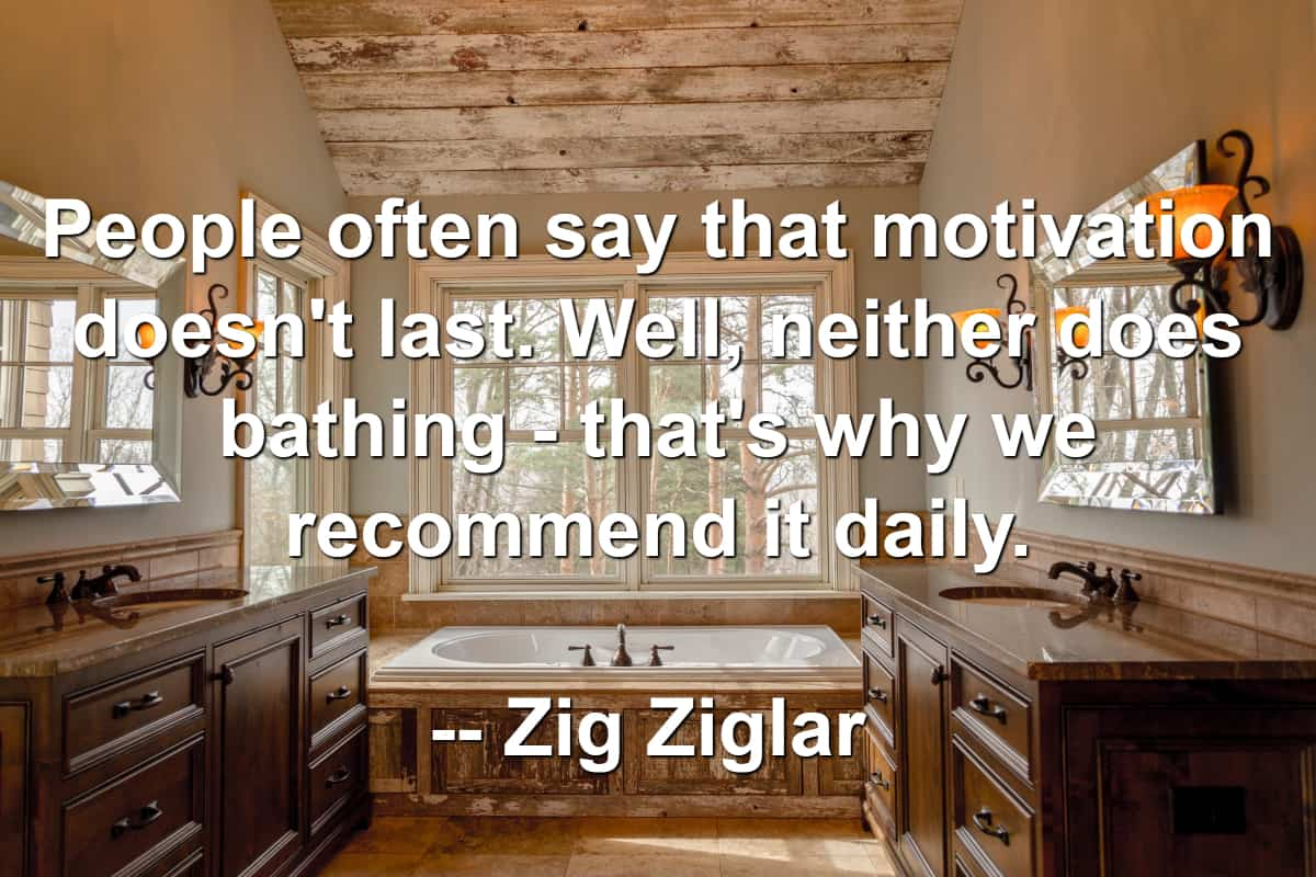Gorgeous bathroom and bath tub with Zig Ziglar quote