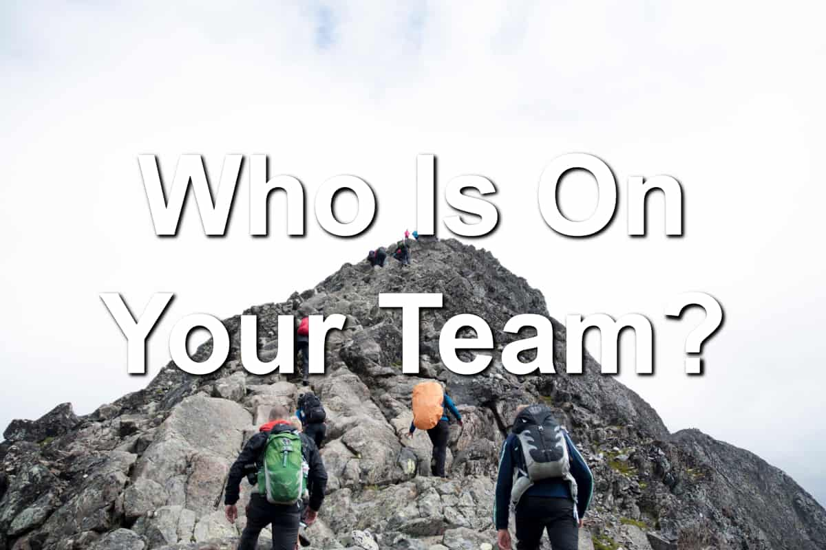 Team of climbers climbing mountain