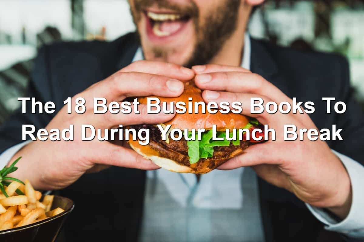 Man in suit eating big hamburger with vegetables