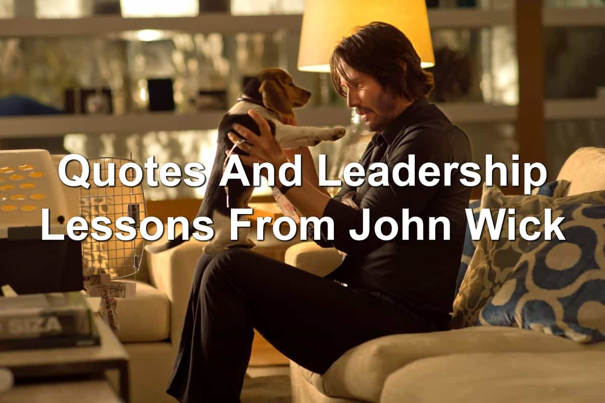 Keanu Reeves in John Wick holding a Beagle puppy