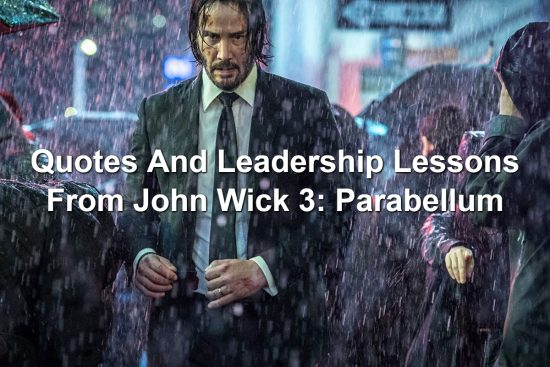 John Wick standing in a downpour