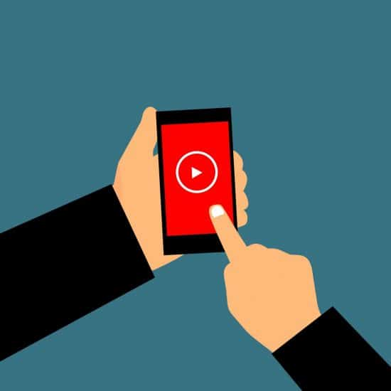 Animated person touching an iPhone screen to play video