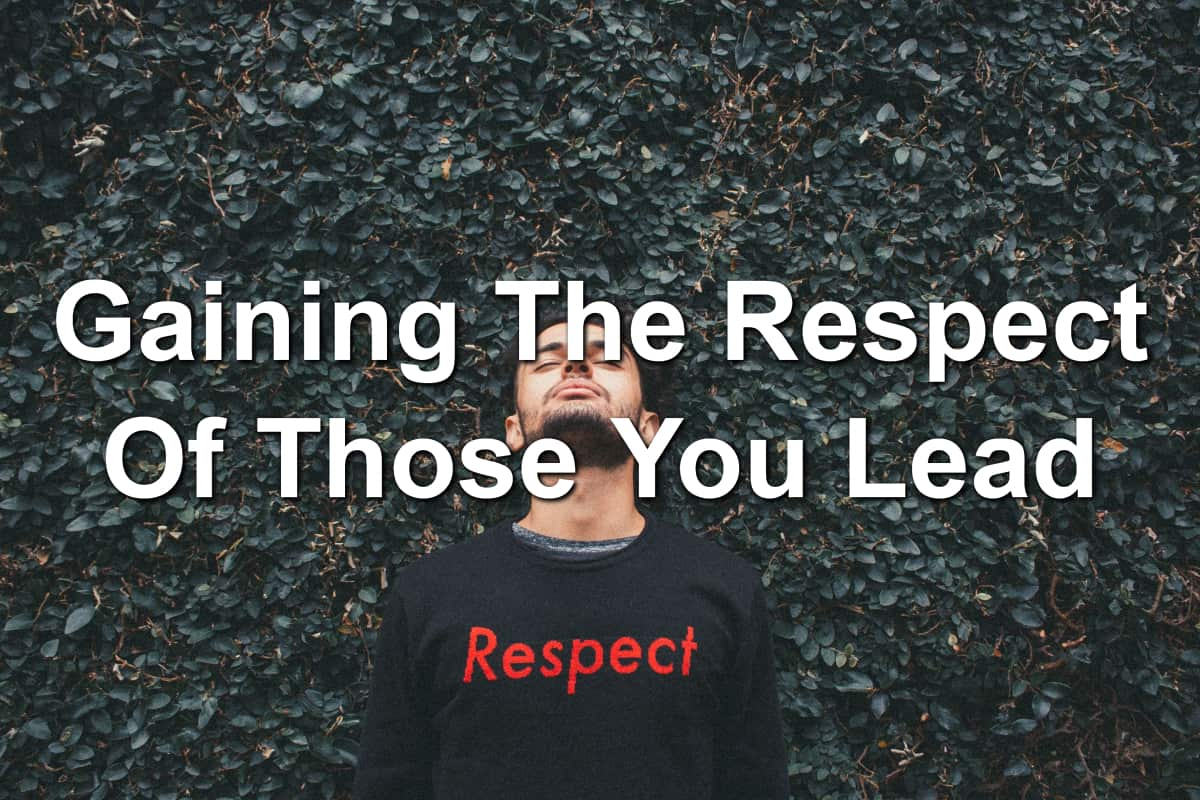 Man wearing a shirt saying respect. Standing in front of a leaf background