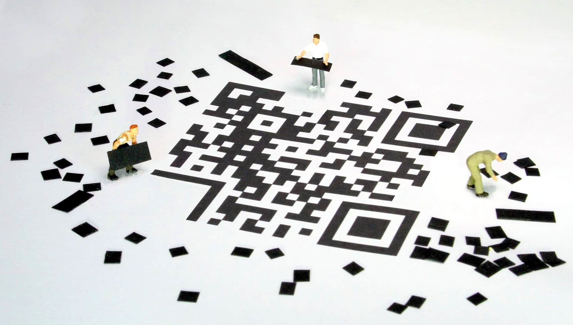 Men working on giant QR code