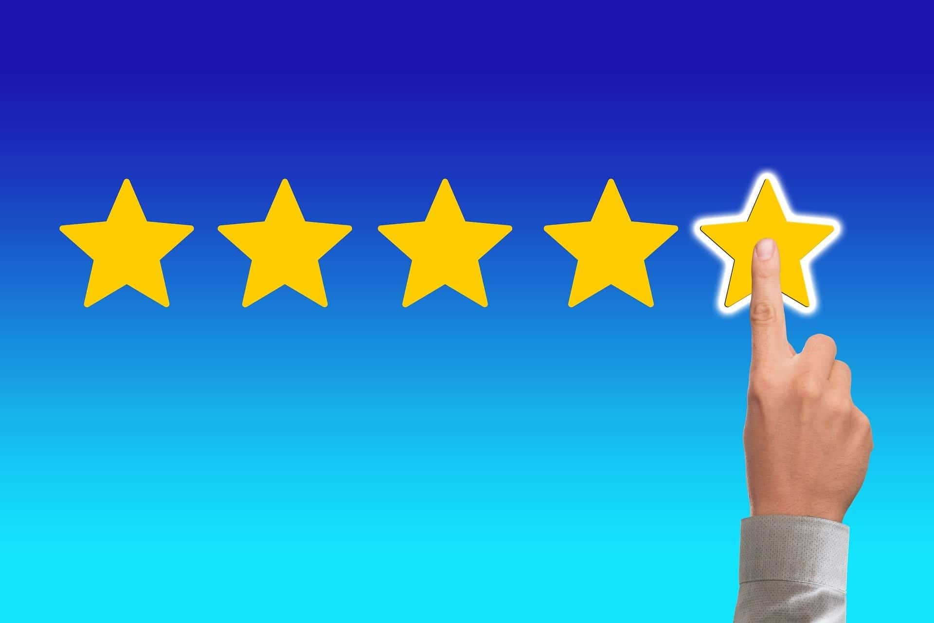 Finger touching 5 star review
