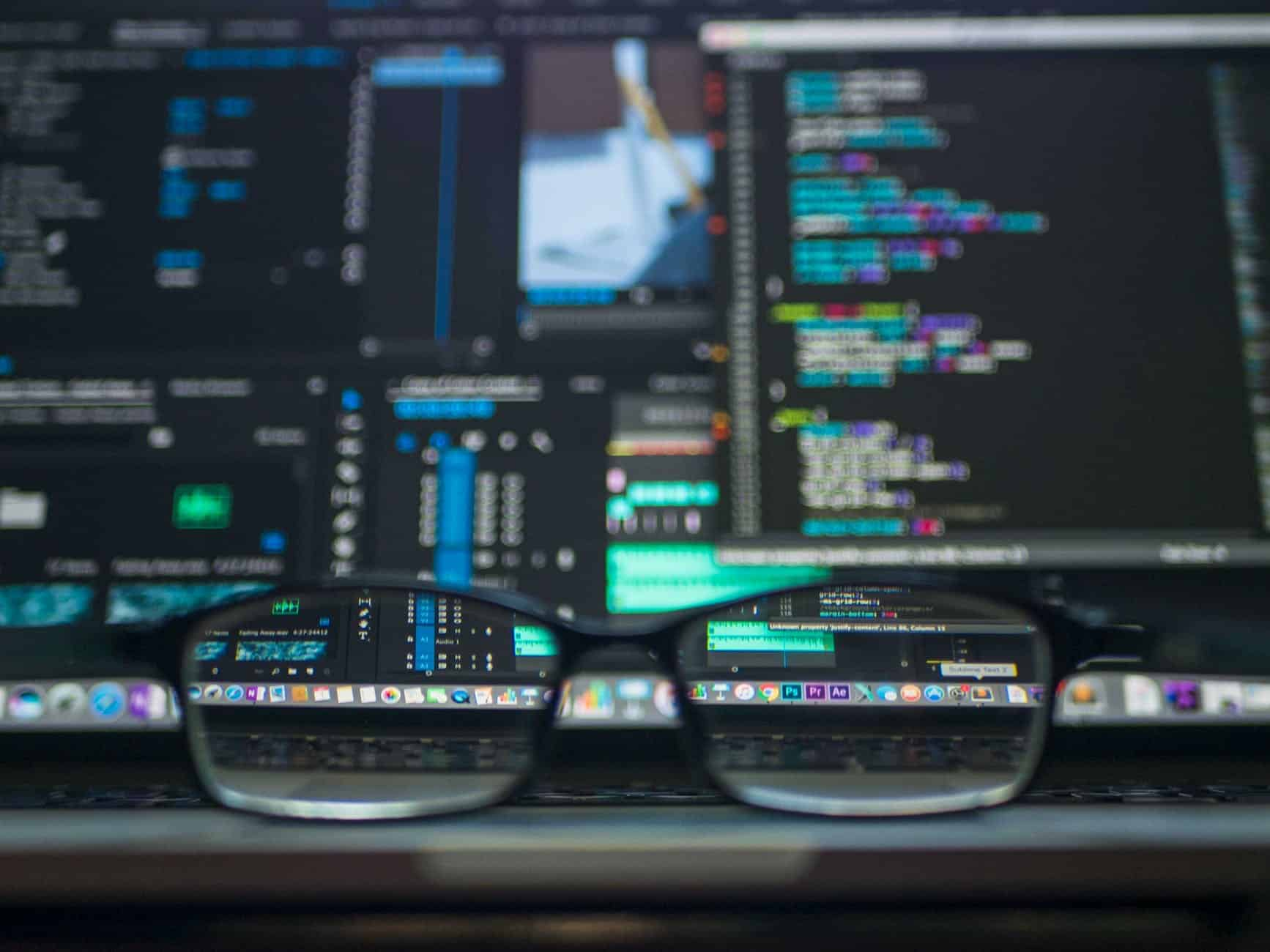 Glasses in front of a computer monitor