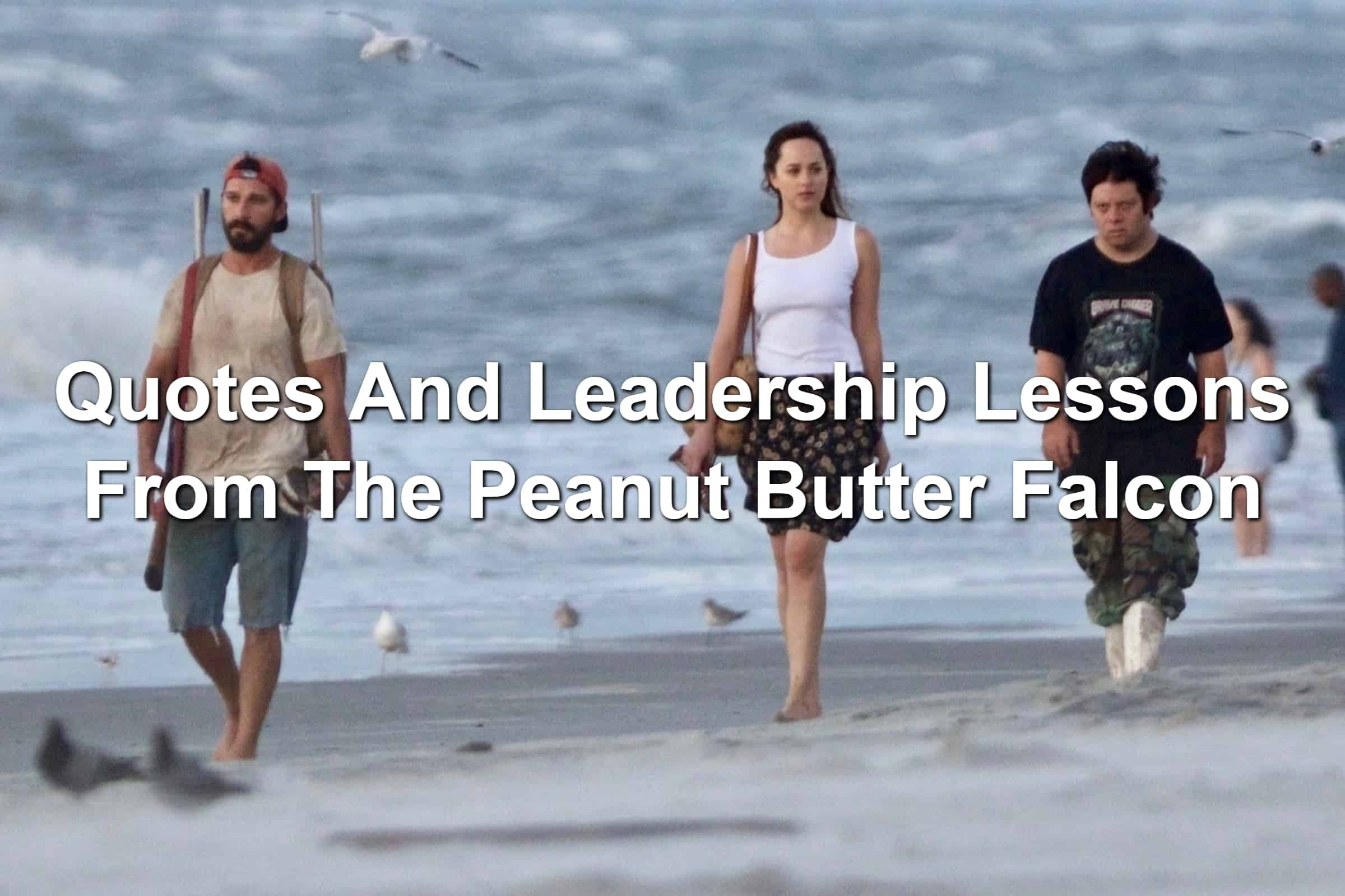 Shia LeBeouf, Dakota Johnson, and Zack Gottsagen walking along a beach in The Peanut Butter Falcon