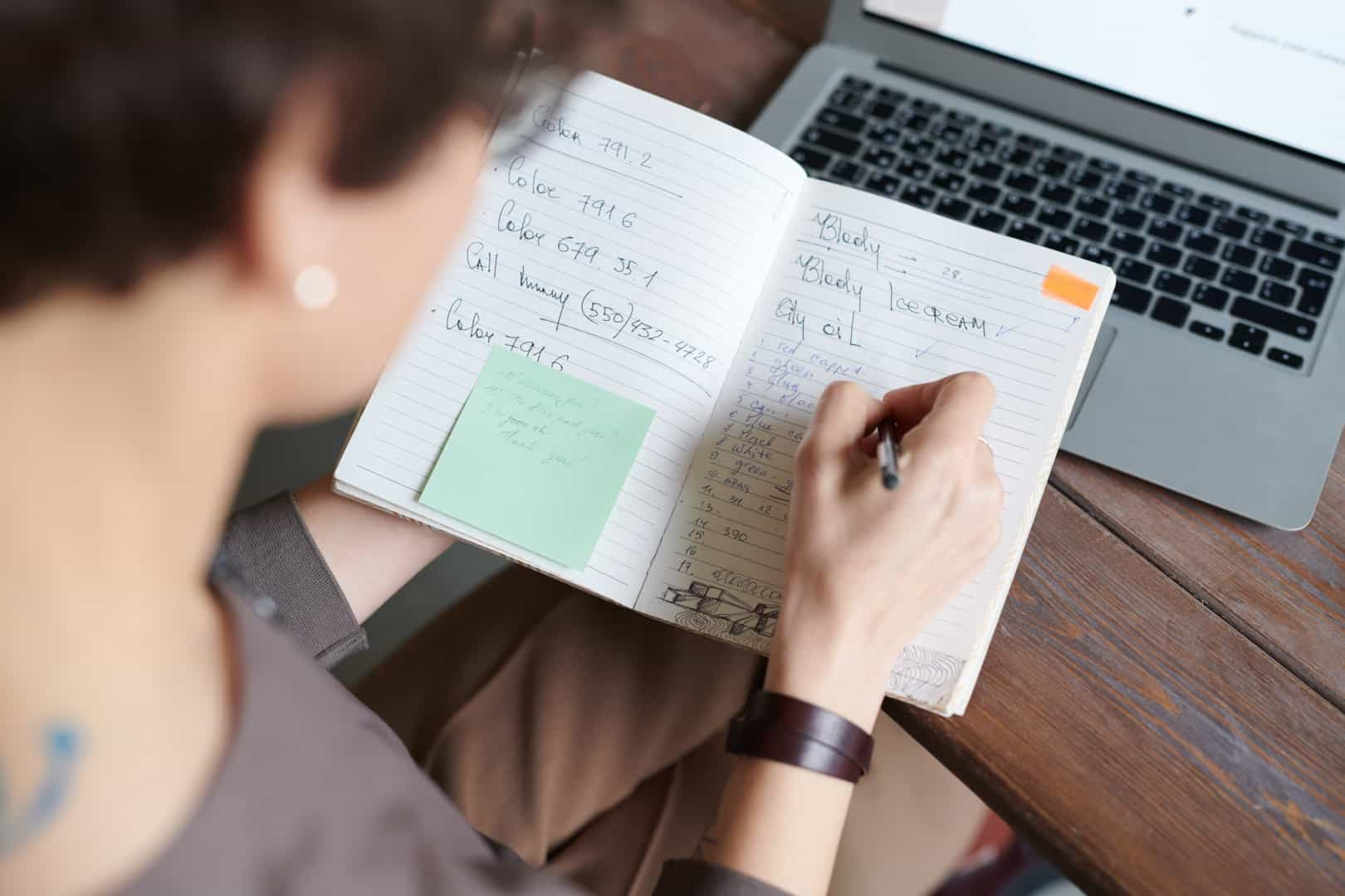 Woman writing in a calendar journal