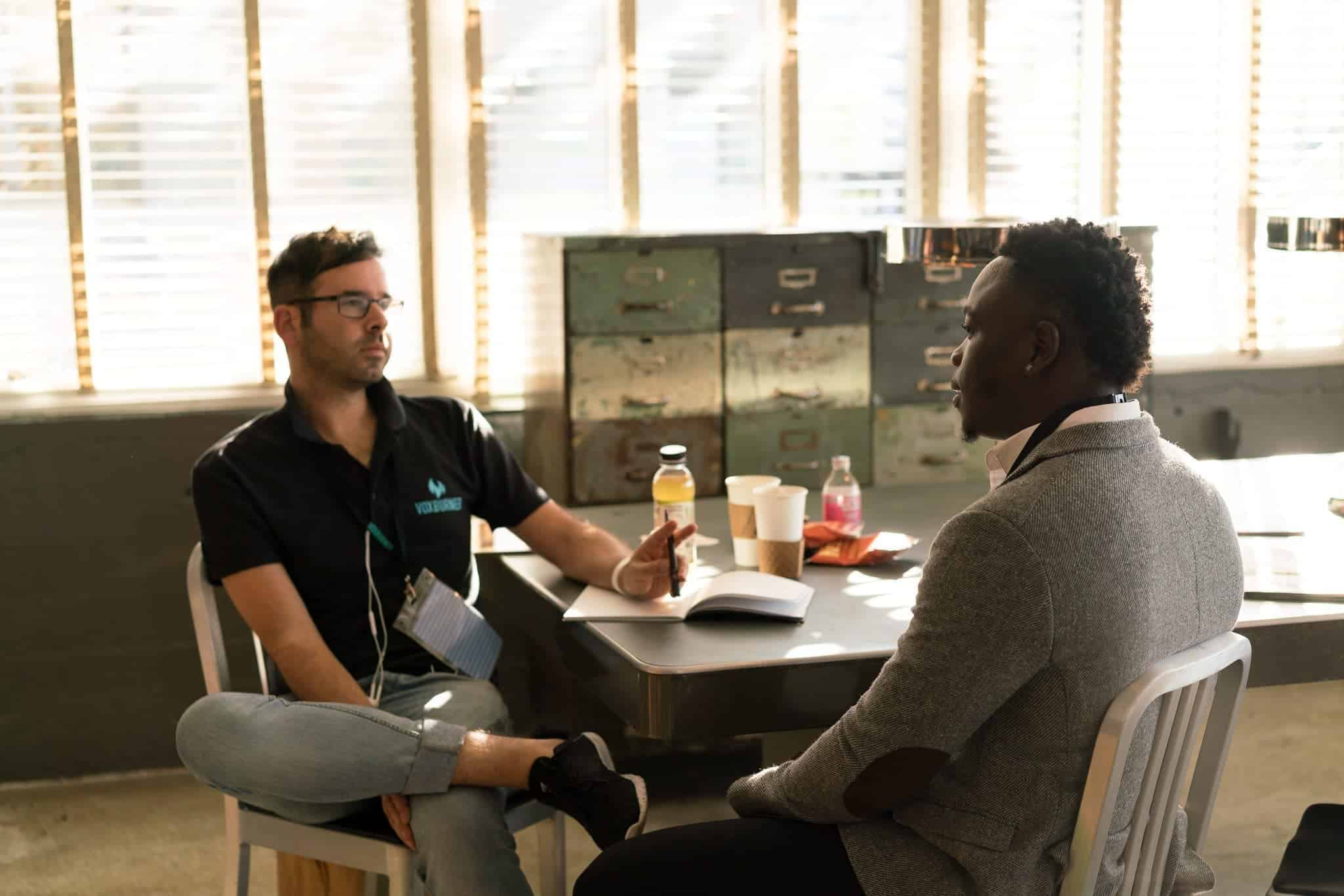 Two men sitting at a table