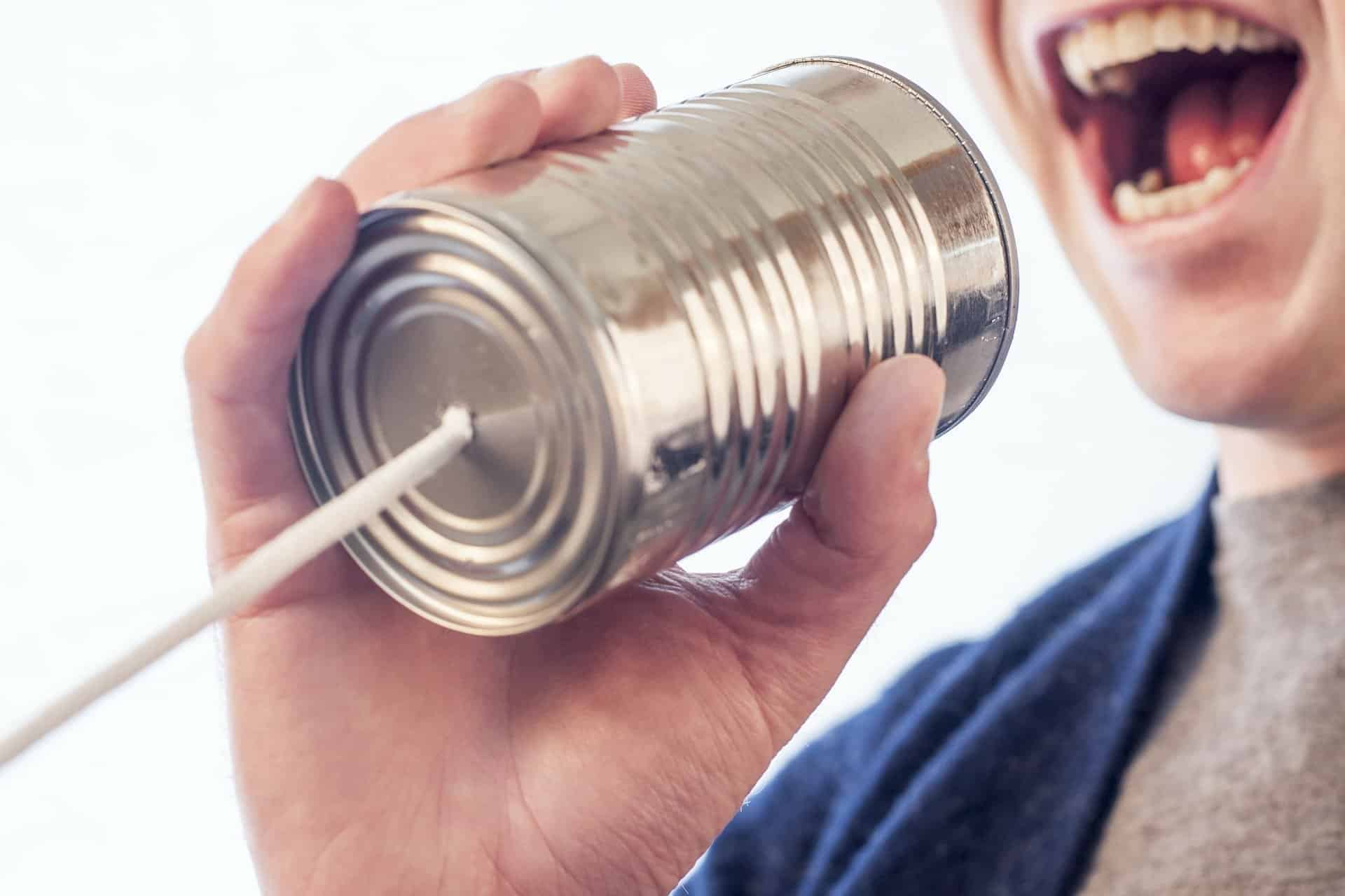 makeshift communication device using a soup can and string