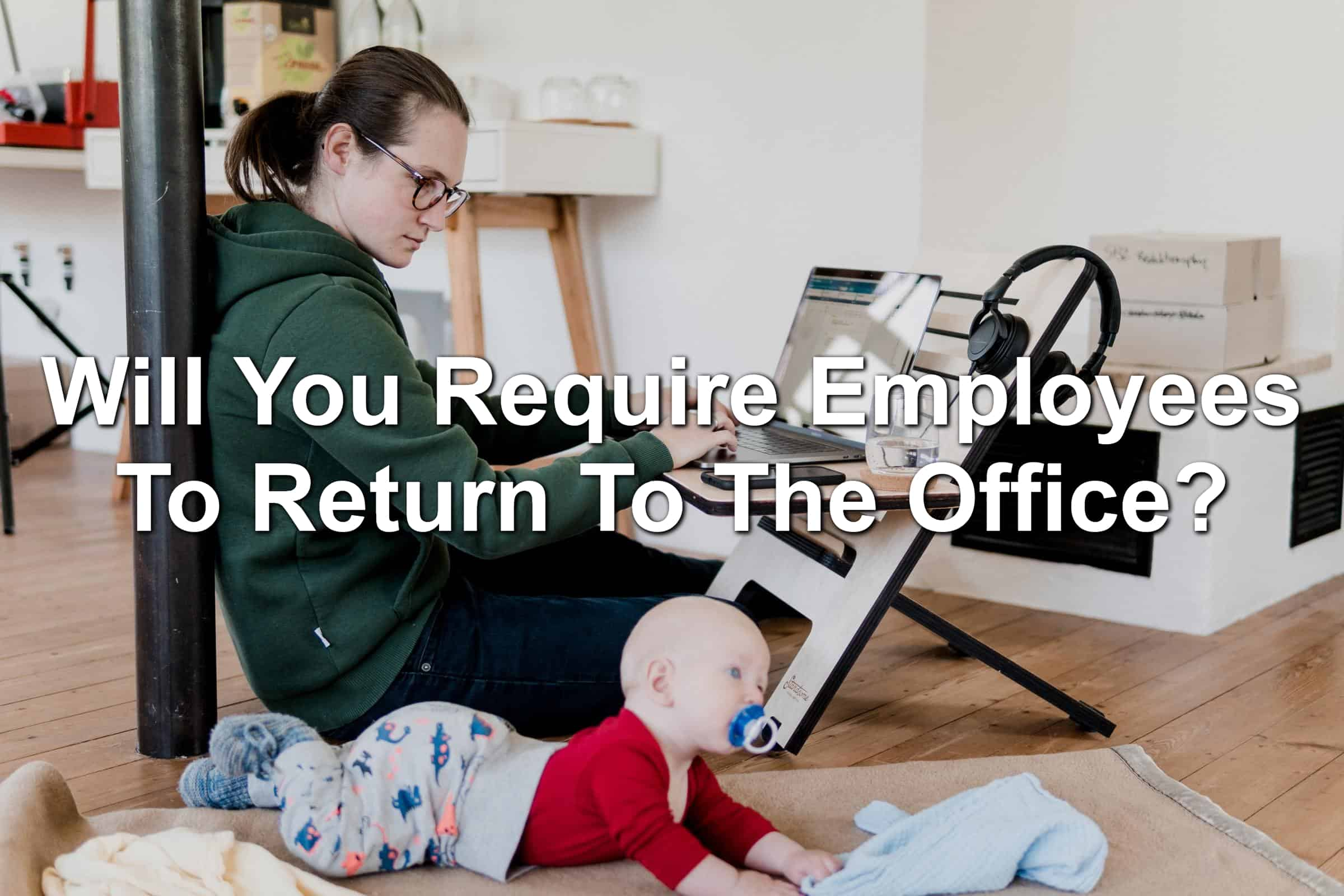 Woman working from home with a baby in the foreground.
