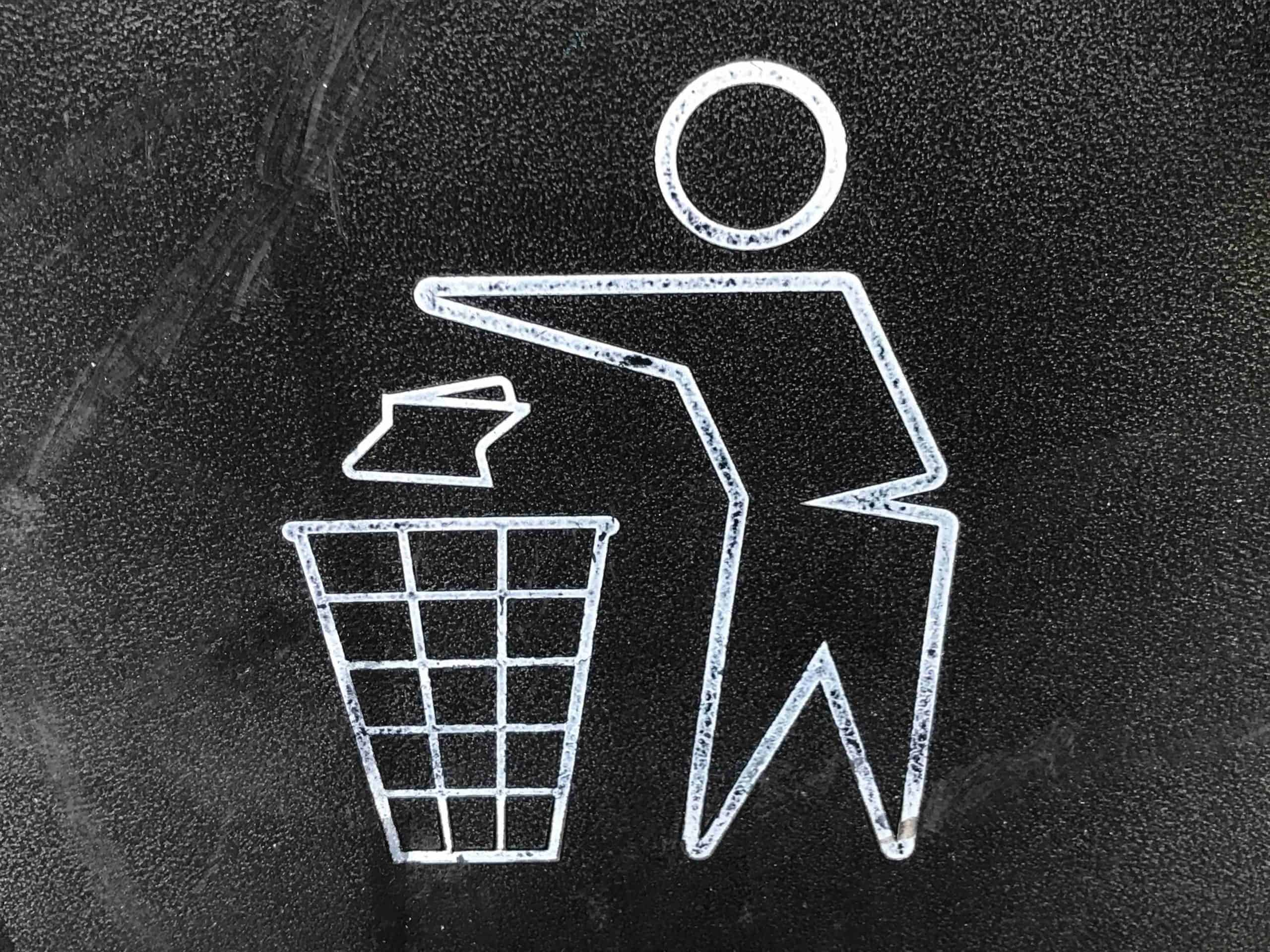 Drawing of a man tossing trash into a garbage can