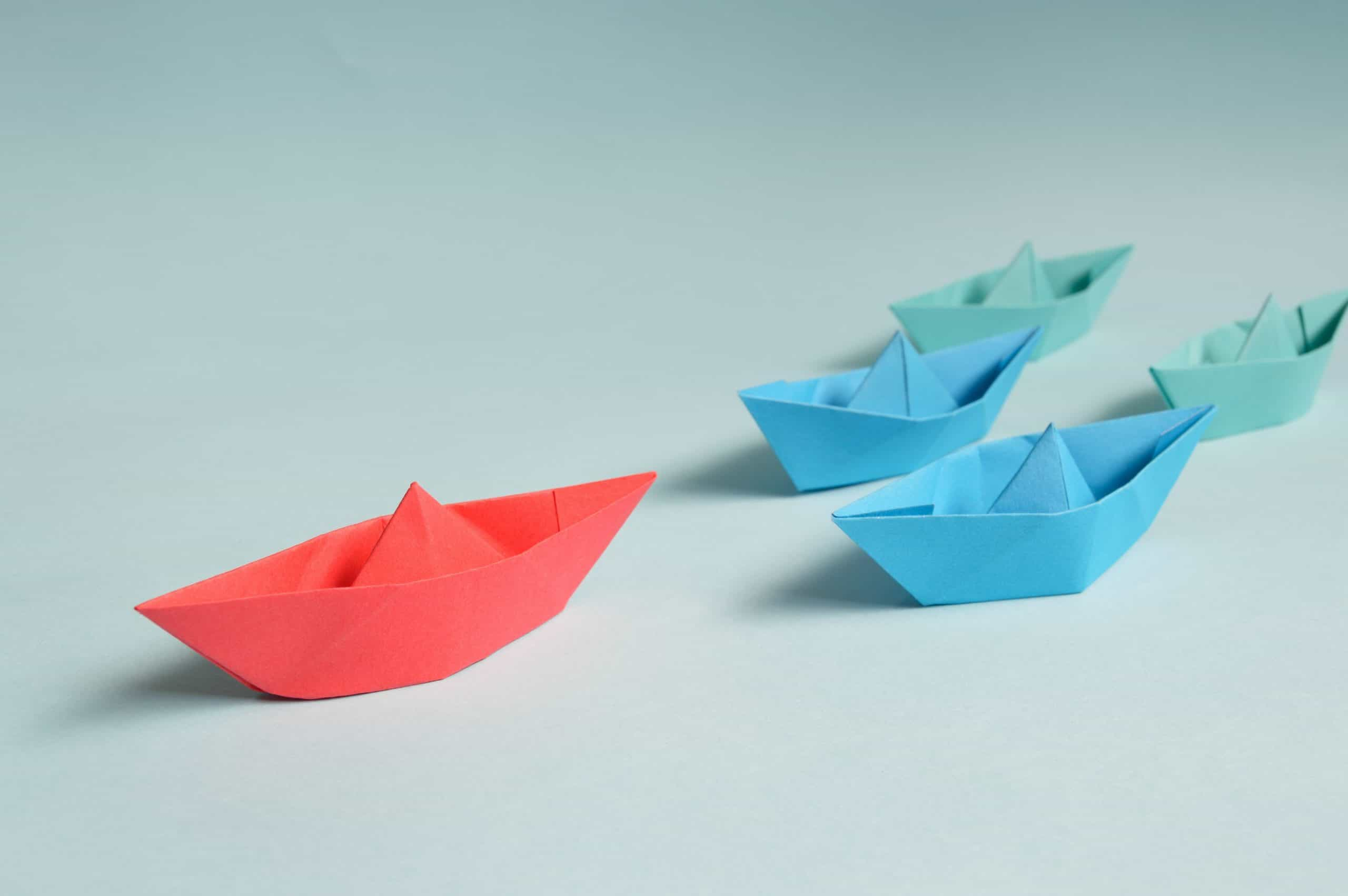 Blue and red origami boats