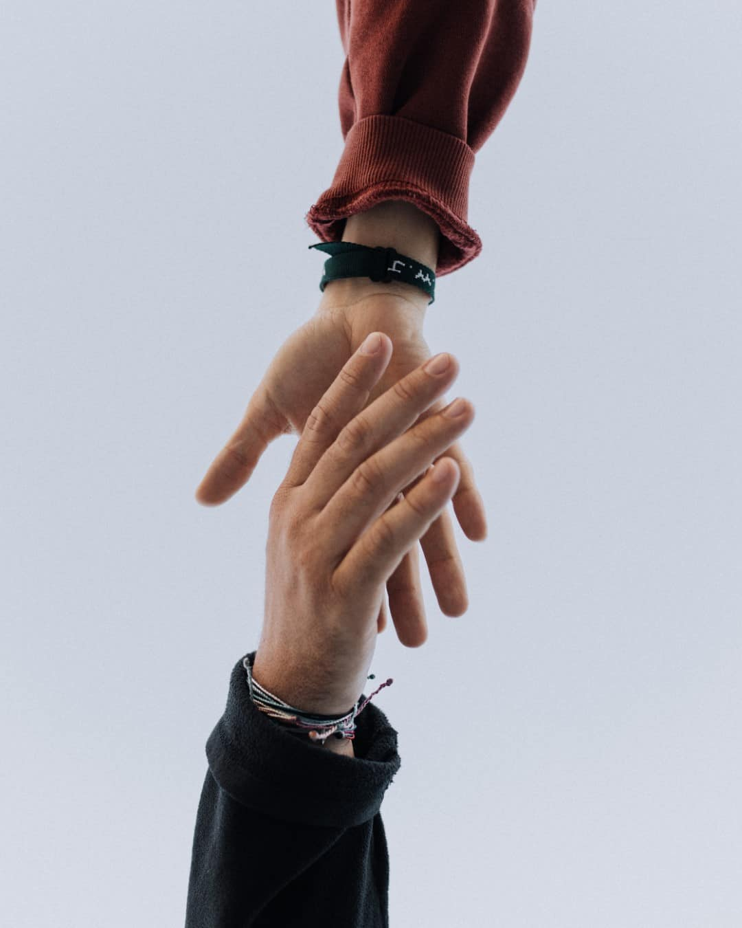 Two people grabbing each others hands